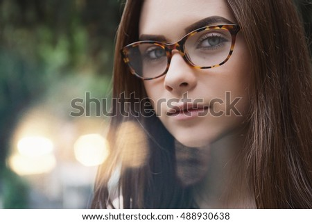 close up Portrait of a girl in glasses