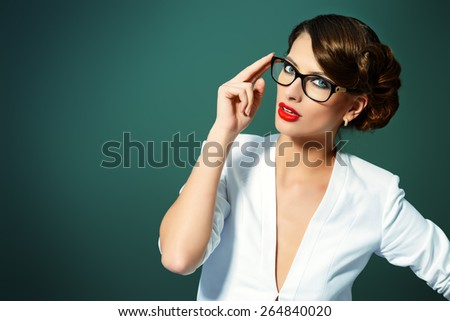 Close-up portrait of a gorgeous young woman wearing glasses. Beauty, fashion. Make-up. Optics, eyewear.  - stock photo