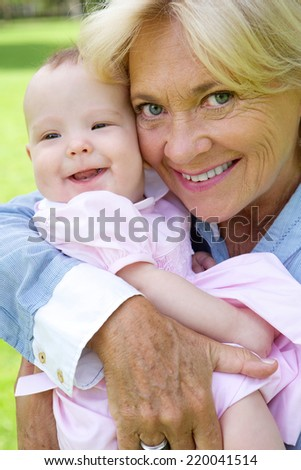 Close up portrait of a grandmother and grandchild smiling - stock photo