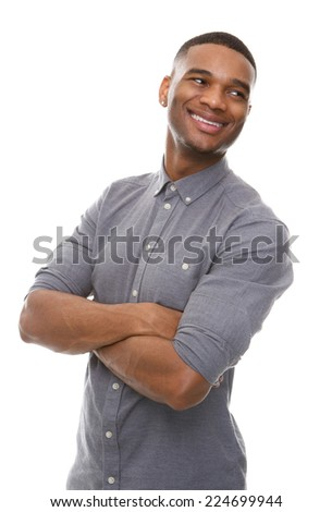 Close up portrait of a handsome black man smiling with arms crossed - stock photo