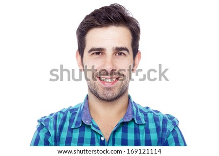 Close-up portrait of a handsome latin man smiling, isolated over a white background