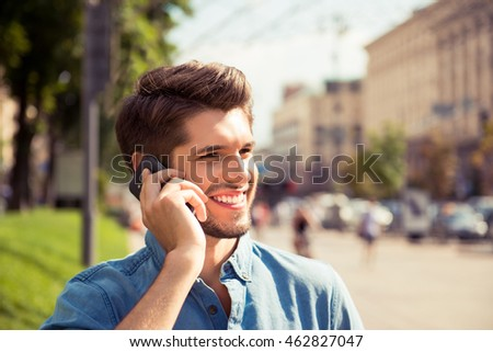 Close up portrait of a handsome man talk on phone and walk street