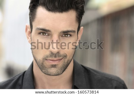 Close up portrait of a handsome young man - stock photo