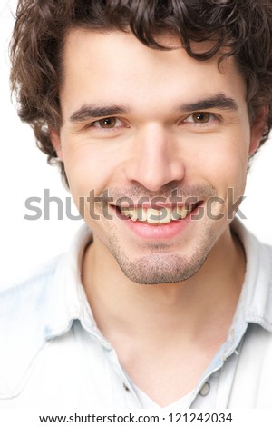Close up portrait of a handsome young man smiling. Isolated on white background - stock photo