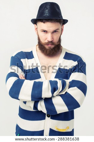 Close up portrait of a handsome young man with beard.  - stock photo