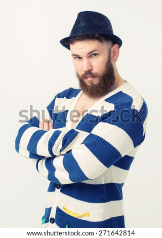 Close up portrait of a handsome young man with beard. Man with his arms crossed over isolated background - stock photo