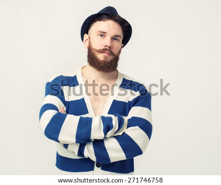 Close up portrait of a handsome young man with beard smiling - stock photo