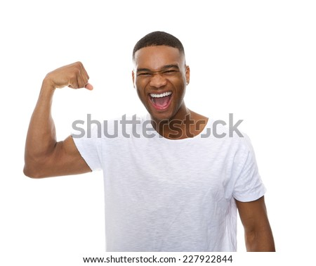 Close up portrait of a happy african american man flexing arm muscle - stock photo