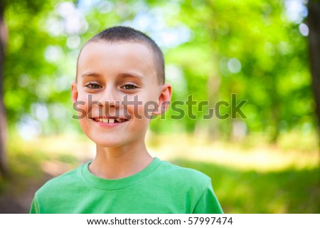 Close up portrait of a happy child outdoor - stock photo
