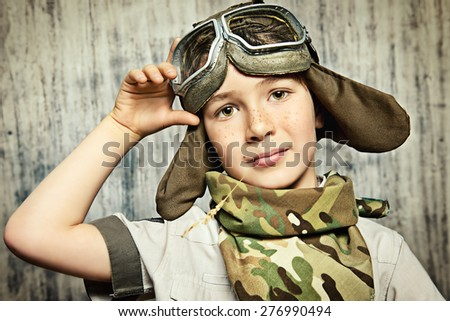 Close-up portrait of a happy kid who dreams of becoming a pilot. Childhood. Fantasy, imagination.  - stock photo