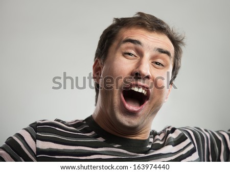 Close-up portrait of a happy man - stock photo
