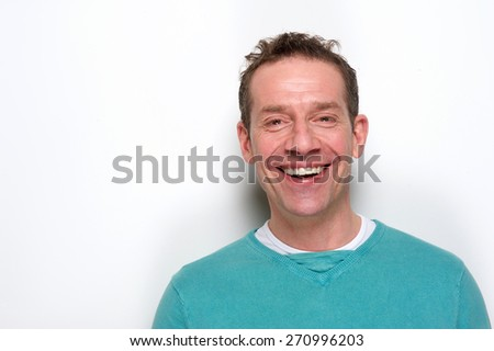 Close up portrait of a happy mid adult man laughing on white background