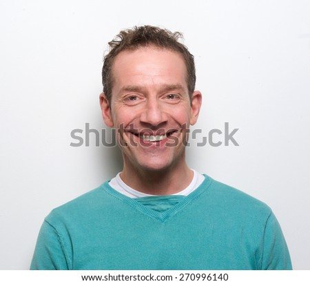 Close up portrait of a happy middle aged man smiling on white background - stock photo