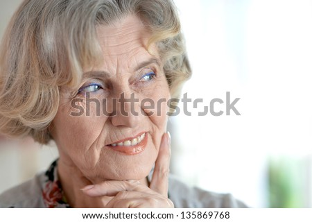 close-up portrait of a happy older woman in studio