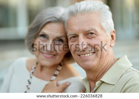 Close-up portrait of a happy senior couple outdoor - stock photo