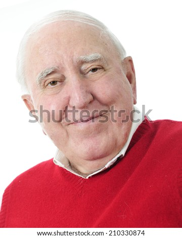 Close-up portrait of a happy senior man in a red sweater.  Isolated on white. - stock photo