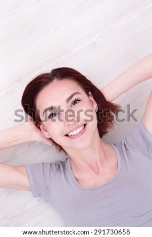 Close up portrait of a Happy young beautiful woman relax lying and smile to you, caucasian beauty - stock photo