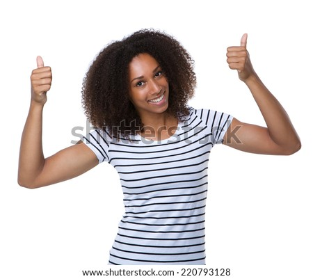 Close up portrait of a happy young woman smiling with thumbs up  - stock photo