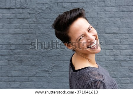 Close up portrait of a happy young woman with short hair
