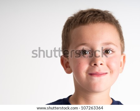 Close-up portrait of A little boy isolated on white background - stock photo