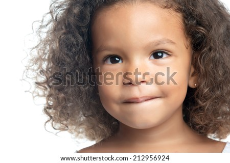 Close up portrait of a little girl with an afro hairstyle - stock photo