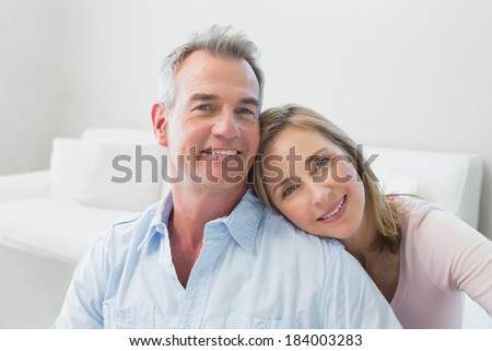 Close-up portrait of a loving couple in the living room at home