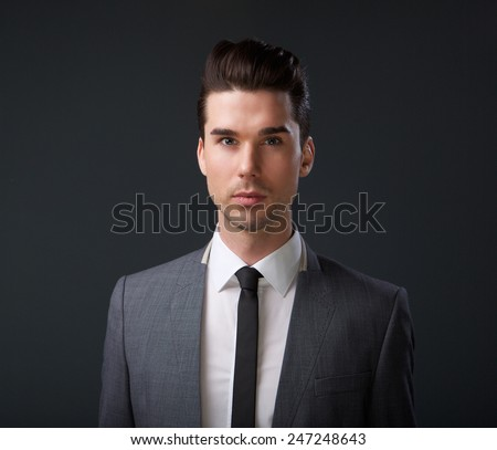 Close up portrait of a male fashion model in gray suit and tie