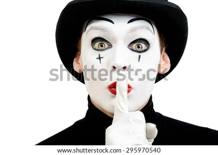 Close-up portrait of a male mime artist showing secret. Isolated over white. - stock photo