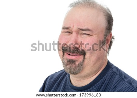 Close-up portrait of a man laughing with a disbelief expression - stock photo