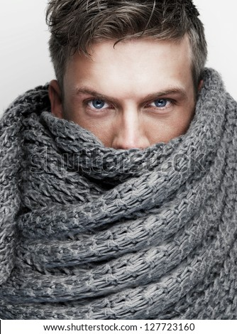 Close up portrait of a man with scarf covering face