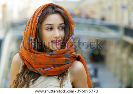 Close up portrait of a muslim young woman wearing a head scarf indoor