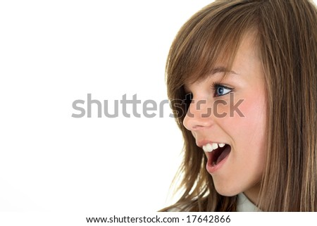 Close-up portrait of a nice teenager. Looking left into the corner. Lots of copyspace and room for text on this isolate. - stock photo