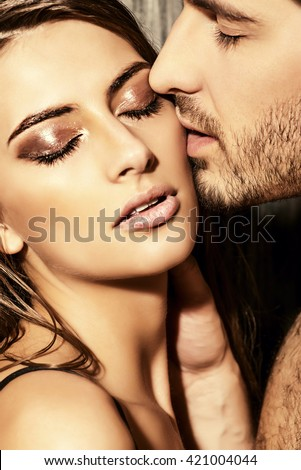 Close-up portrait of a passionate young people in love. - stock photo