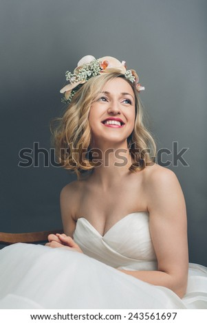 Close up portrait of a pretty blond bride smiling with happiness