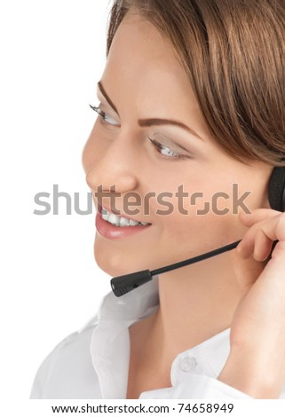 Close-up portrait of a pretty young female call center employee wearing a headset, against white background - stock photo