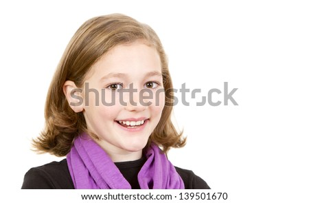 Close up portrait of a pretty young schoolgirl with dark blonde hair and brown eyes smiling charmingly, isolated on white. - stock photo