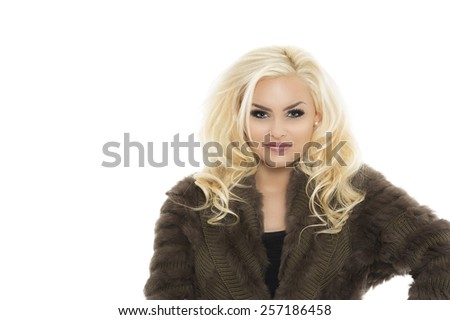 Close up Portrait of a Pretty Young Woman with Wavy Long Blond Hair, Wearing Trendy Furry Knitted Coat Dress, Smiling at the Camera. Isolated on White Background. - stock photo
