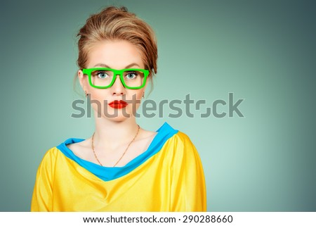 Close-up portrait of a pretty young womanl posing in vivid colourful clothes and glasses. Bright fashion. Optics, eyewear. Studio shot. - stock photo