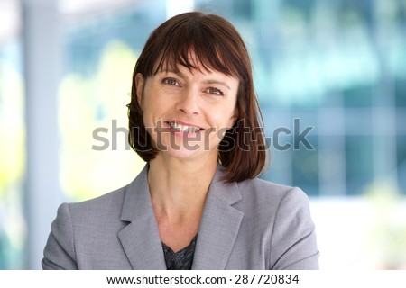 Close up portrait of a professional business woman smiling outdoor - stock photo