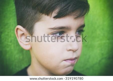 Close up portrait of a sad teenager - stock photo