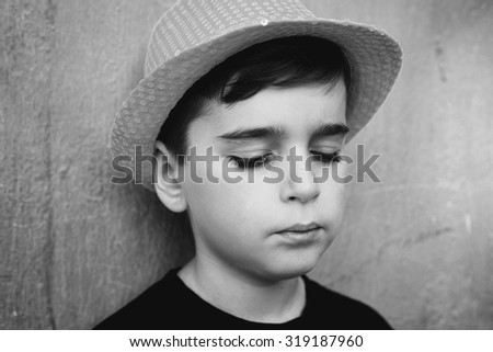 Close up portrait of a sad teenager in hat - stock photo