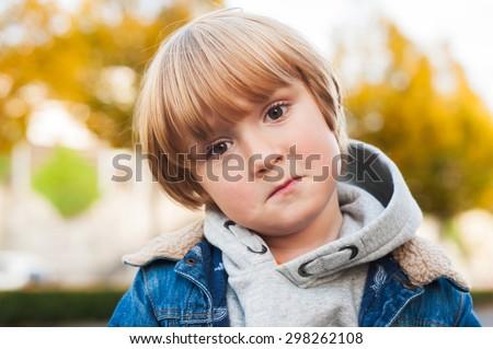 Close up portrait of a sad toddler boy - stock photo