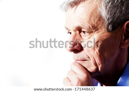 close-up portrait of a senior man thinking
