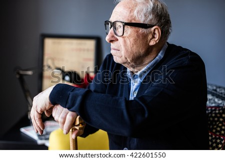 close-up portrait of a senior man thinking about his past - stock photo