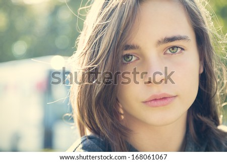 close up portrait of a sensitive female teenager .