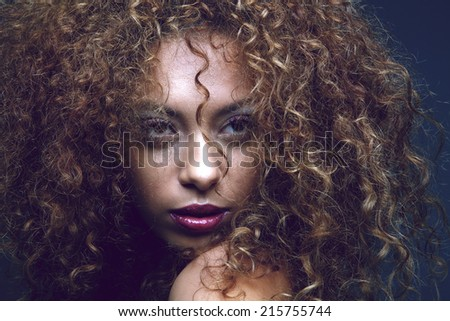 Close up portrait of a sensual black female fashion model  - stock photo