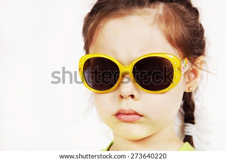 Close up portrait of a serious cute little girl - stock photo