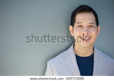 Close up portrait of a smiling asian man  - stock photo
