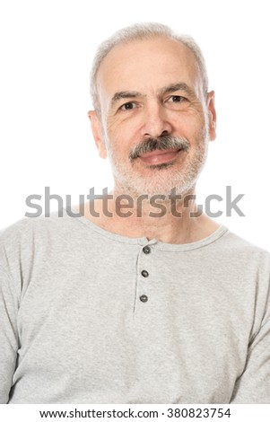 Close up portrait of a smiling attractive senior man looking directly at the camera with white background - stock photo