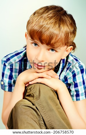 Close-up portrait of a smiling boy at studio. - stock photo